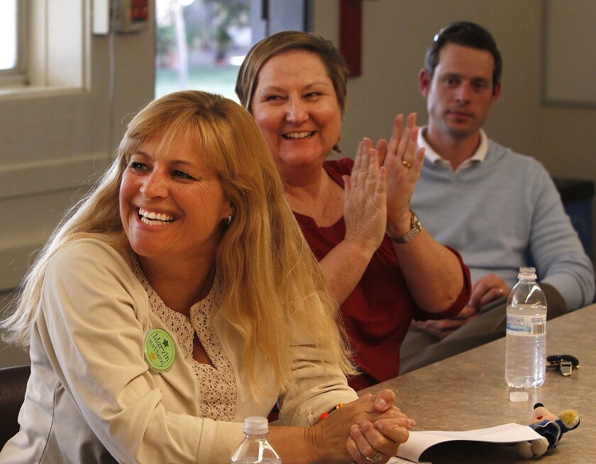 Marvin Elementary teachers Trish Livingstone (left) and Patricia Leverton celebrate the news that their school will likely stay open.