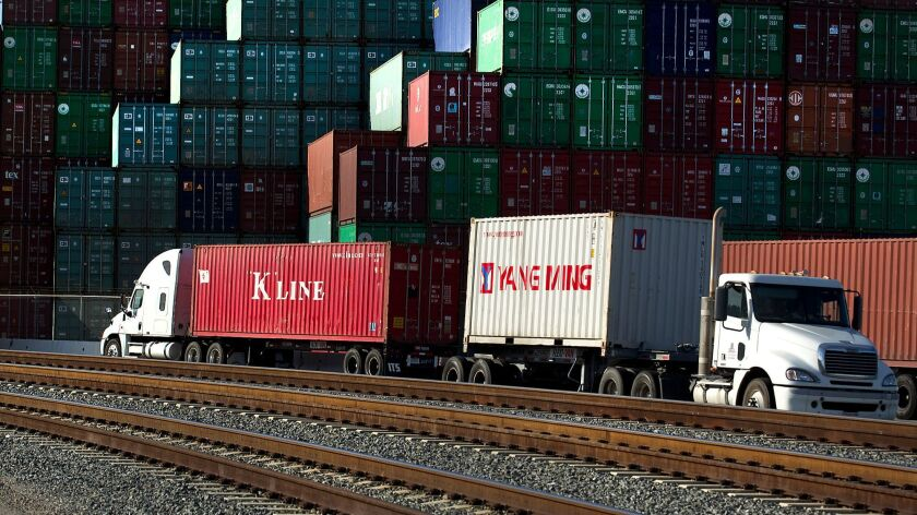 LOS ANGELES, CA - APRIL 8, 2014: Container traffic moves by truck in the Port of Los Angeles April 8