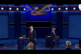 No handshake: Donald Trump and Hillary Clinton greet each other at start of debate