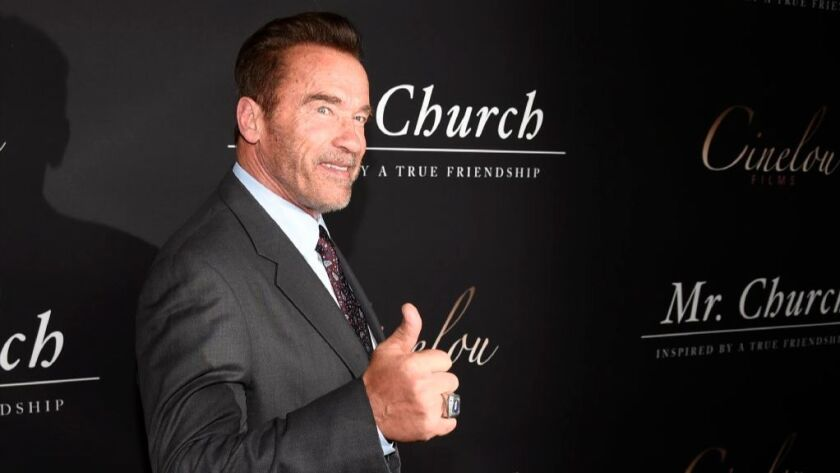 """Arnold Schwarzenegger poses for photographers at the premiere of the film """"Mr. Church"""" at the ArcLight Hollywood on Tuesday, Sept. 6, 2016, in Los Angeles."""