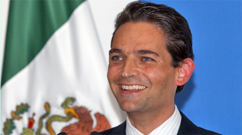 NEW POST: Juan Camilo Mouriño speaks to reporters after his appointment as interior secretary. Mouriño's Spanish birth may hamper any aspirations to the Mexican presidency.