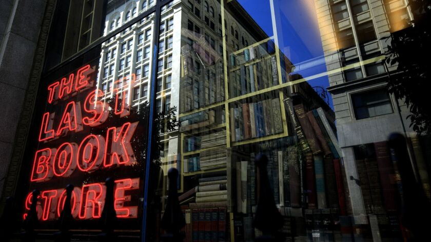 LOS ANGELES ,CA., MARCH 30 2019: The neon sign in the window of the Last Bookstore reflects the past