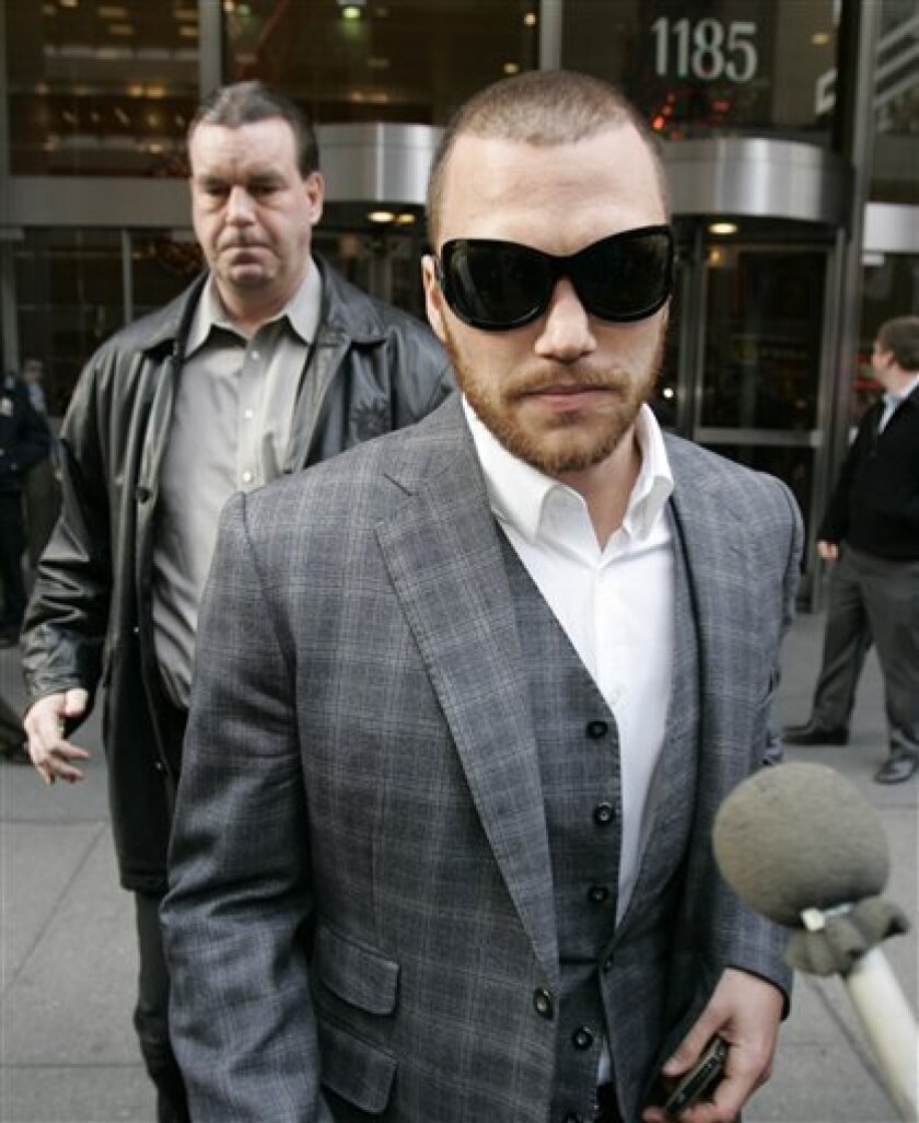 Dallas Stars forward Sean Avery leaves a meeting with NHL commissioner Gary Bettman Thursday, Dec. 4, 2008 in New York. The NHL suspended Avery indefinitely on Tuesday, Dec. 2 for making a crude reference to former girlfriends while talking with reporters. (AP Photo/Frank Franklin II)