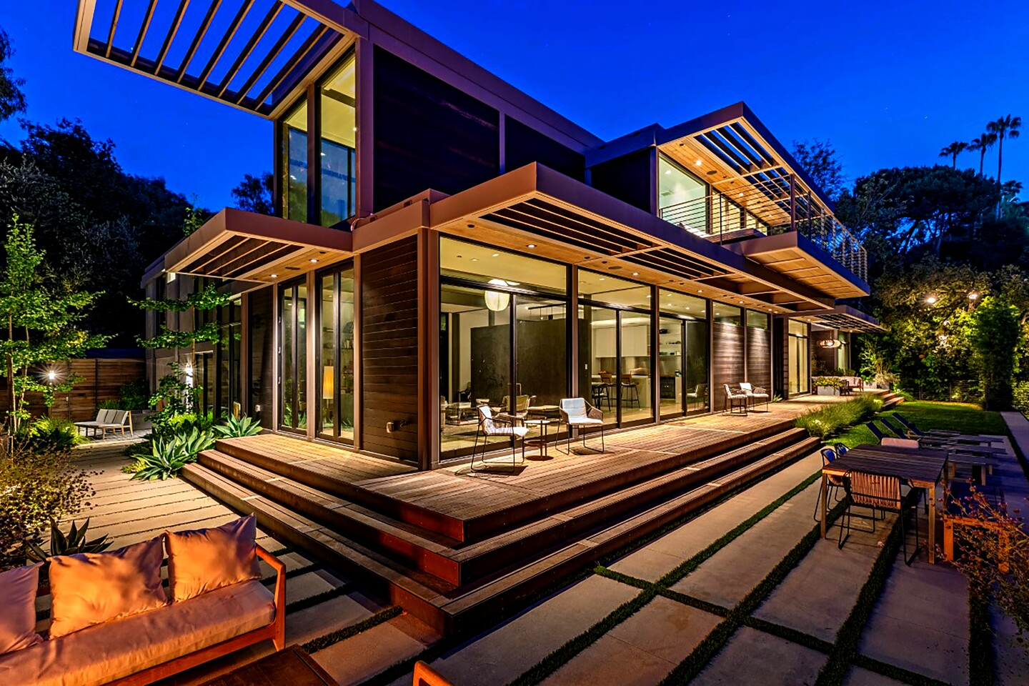 The Westside home of actor Will Arnett, listed for $10.995 million, is comprised of six modules that were built off-site and later assembled on location. Walls of glass, overhanging eaves and open-concept living spaces are among features of the home. Outside, there's tiered decking and a swimming pool.