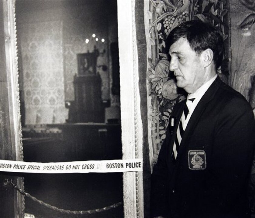FILE - In this March 21, 1990 file photo, a security guard stands outside the Dutch Room of the Isabella Stewart Gardner Museum in Boston, where robbers stole more than a dozen works of art by Rembrandt, Vermeer, Degas, Manet and others, in an early morning robbery. Assistant U.S. Attorney John Dur