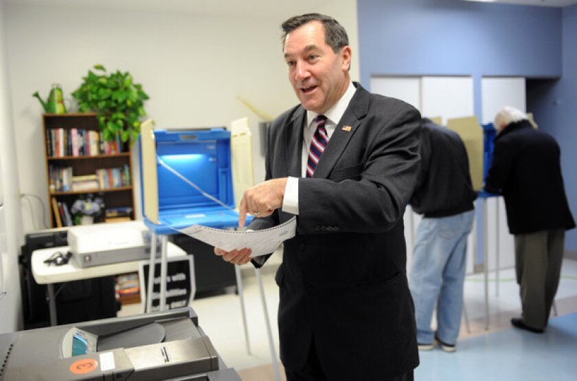 Rep. Joe Donnelly, Indiana Democratic candidate for U.S. Senate, casts his vote in South Bend, Ind.