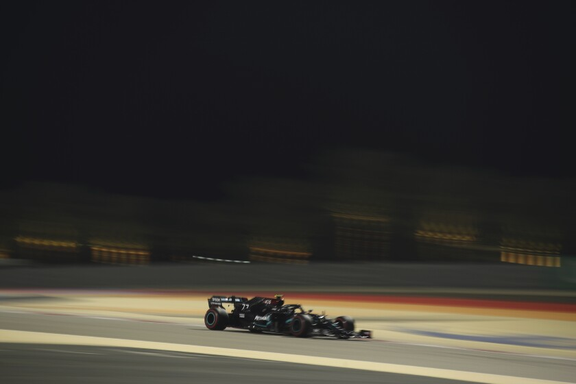 Mercedes driver Valtteri Bottas of Finland steers his car during the third free practice at the Formula One Bahrain International Circuit in Sakhir, Bahrain, Saturday, Dec. 5, 2020. The Bahrain Formula One Grand Prix will take place on Sunday. (Brynn Lennon, Pool via AP)