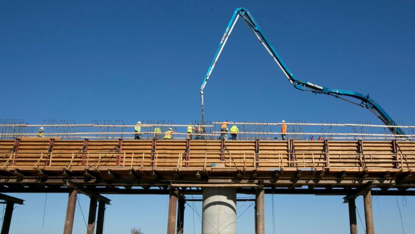 Workers pour concrete Dec. 6 on an elevated section of the high-speed rail line that will cross over the San Joaquin River, near Fresno.