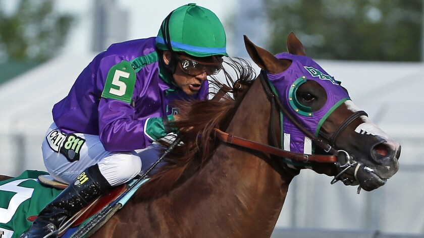 Jockey Victor Espinoza rides California Chrome to victory in the Kentucky Derby on May 3. Espinoza's joy at winning the famed horse race has been matched by his generosity.