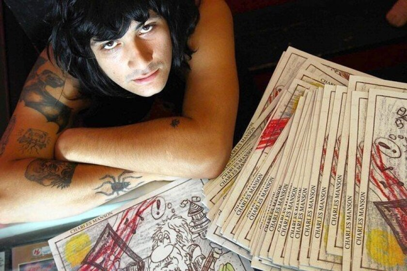 Manuel Vasquez with copies of albums containing the songs of Charles Manson. Vasquez has befriended Manson in prison and believes his followers carried out the killings of August 1969 on their own.