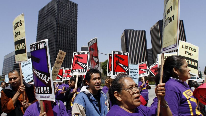 Union janitors and supporters rally in Century City in 2012 over wages and affordable healthcare.