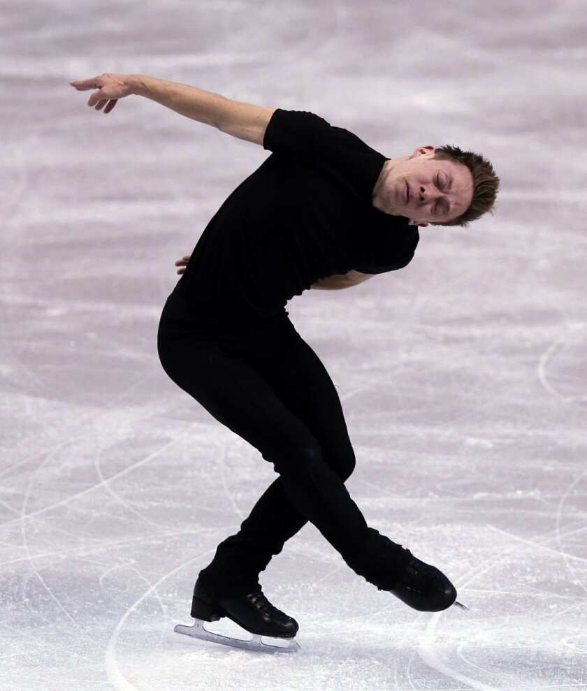 Grant Hochstein, of the United States, is show during a men's practice session prior to the World Figure Skating Championships in Boston, Monday, March 28, 2016. The 25-year-old American is accomplished enough to set a goal of qualifying for the next Olympics, but not famous enough to earn big endorsement deals to pay for all that goes into that. So he spends 12-hour days at the rink, alternating between coaching and being coached. (AP Photo/Charles Krupa)