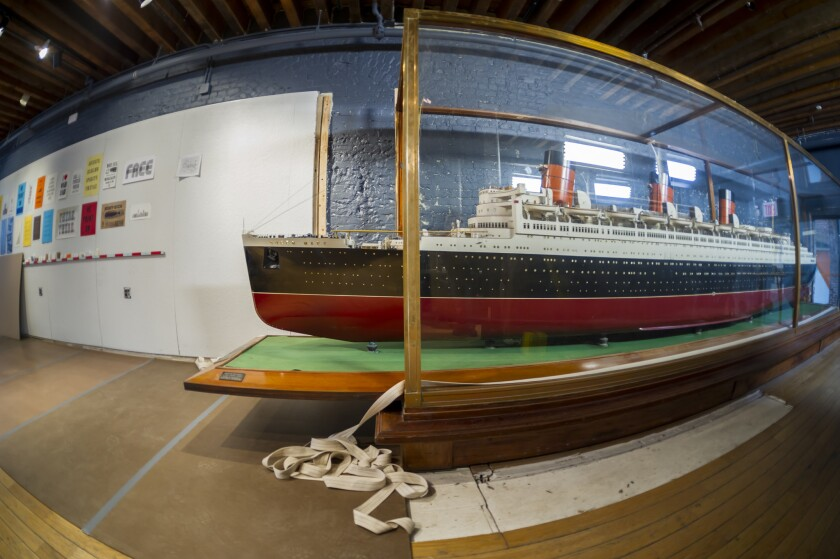 The shipbuilder's model of the Queen Mary is prepared to be moved from the South Street Seaport Museum in New York City last month. It's going on display at the Queen Mary in Long Beach.