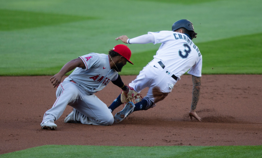 Seattle's J.P. Crawford beats the tag of Angels shortstop Luis Rengifo to steal second base.