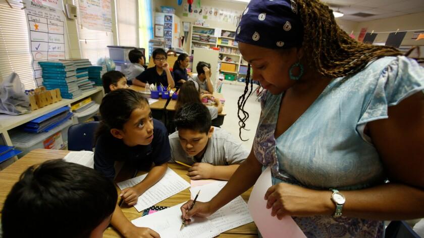 Magnolia teacher Teri Jackson with students