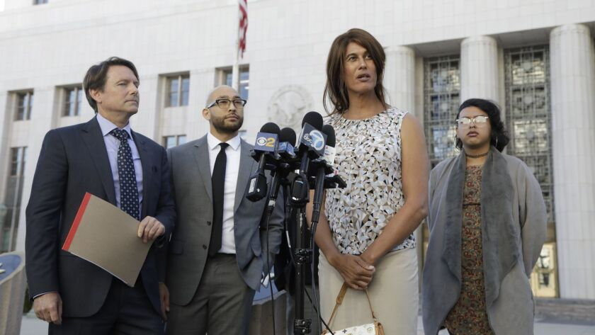 Zhoie Perez, second from right, speaks during a news conference in downtown Los Angeles.