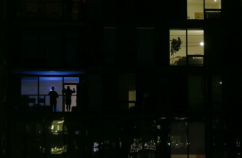 Residents in an apartment building in Hollywood, where a stay-at-home order is in effect to help curb the spread of the coronavirus.