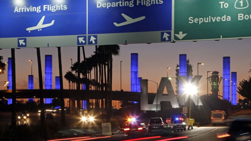 Lighted pylons at the Century Boulevard entrance to Los Angeles International Airport, where parking may be tight.