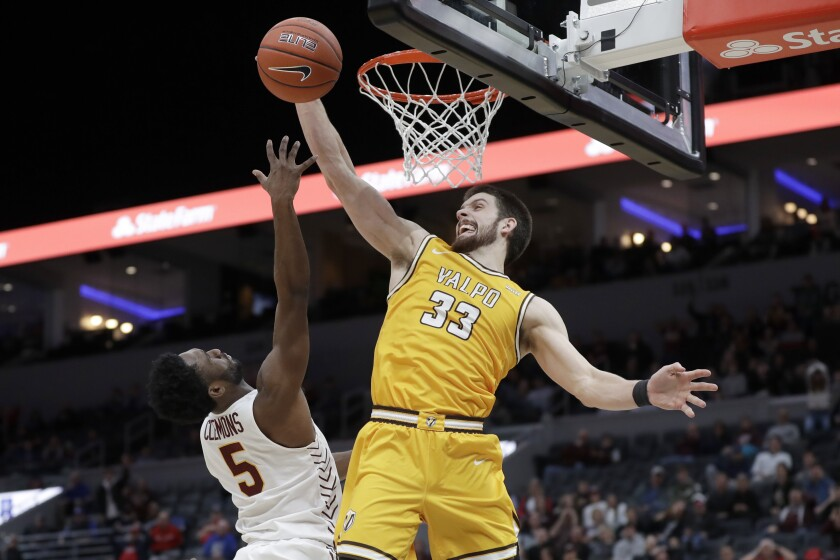Valparaiso's John Kiser (33) knocks the ball away from Loyola of Chicago's Keith Clemons (5) during the second half of an NCAA college basketball game in the quarterfinal round of the Missouri Valley Conference men's tournament Friday, March 6, 2020, in St. Louis. Valparaiso won 74-73 in overtime. (AP Photo/Jeff Roberson)