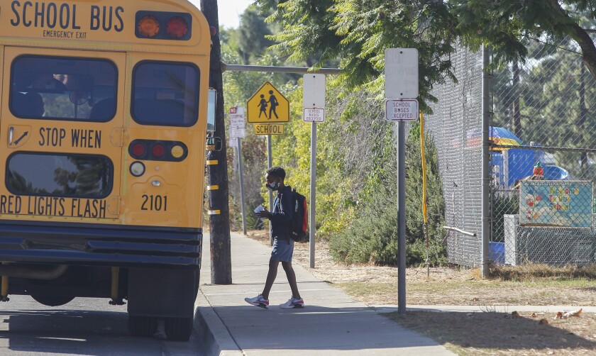 A student boards the bus at Lafayette Elementary School in San Diego in October