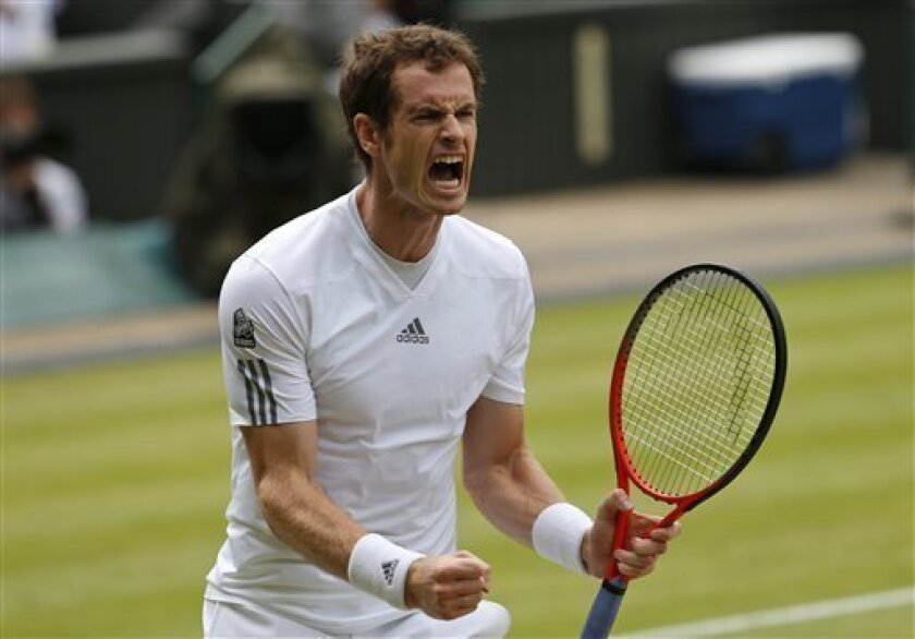 Andy Murray of Britain reacts after winning a point against Fernando Verdasco of Spain during their Men's singles quarterfinal match at the All England Lawn Tennis Championships in Wimbledon, London, Wednesday, July 3, 2013. (AP Photo/Jonathan Brady)
