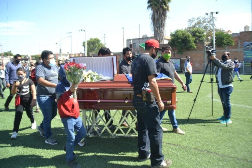 Mourners at the funeral of Israel Vazquez in Salamanca, Mexico.