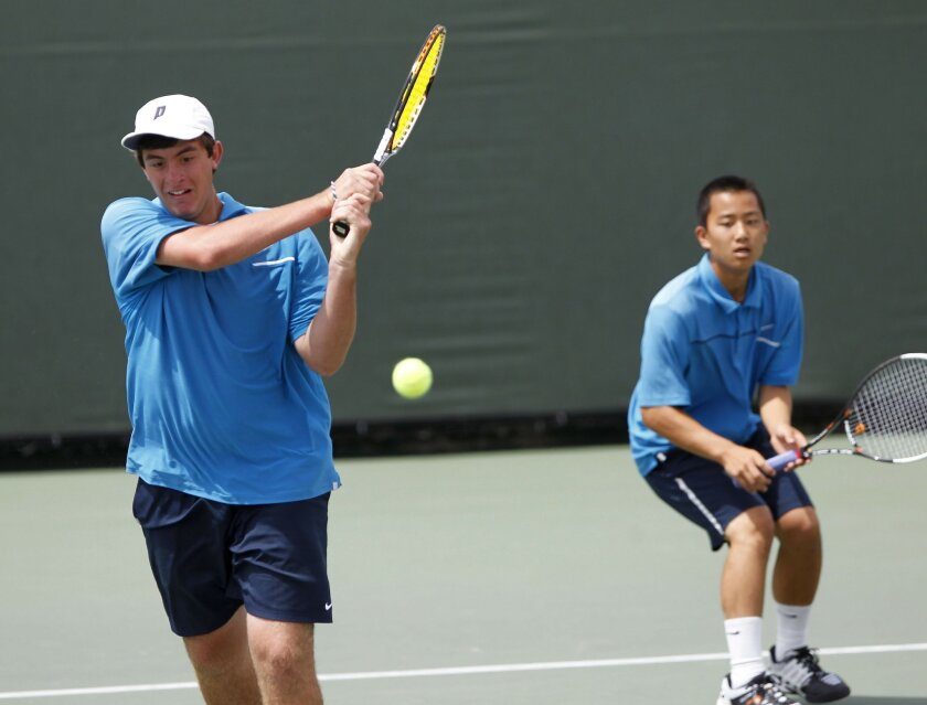 Rancho Bernardo junior Chris Bernhardt (left) and freshman partner Aiku Shintani lost their lead in the second set only to gain it back for an eventual win in the doubles competition.