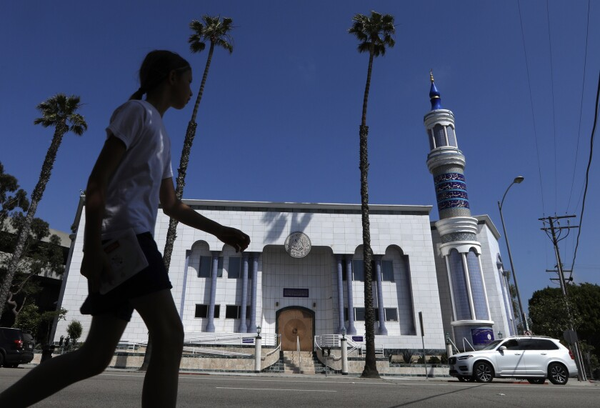 CULVER CITY, CA - MAY 12, 2019 - - A pedestrian walks across the street from the King Fahad Mosque w