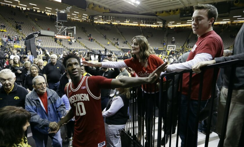 Wisconsin forward Nigel Hayes celebrates with fans after an NCAA college basketball game against Iowa, Wednesday, Feb. 24, 2016, in Iowa City, Iowa. Wisconsin won 67-59. (AP Photo/Charlie Neibergall)