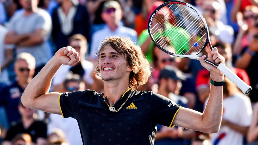 Alexander Zverev celebrates after defeating Roger Federer in the Rogers Cup championship match Sunday.