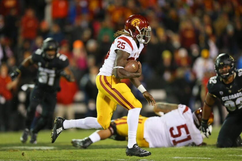 Trojans running back Ronald Jones II picks up yards against the Buffaloes in the first half on Nov. 13.