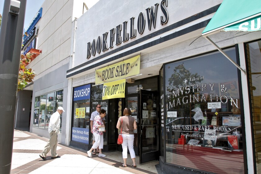 A steady flow of customers enter the Bookfellows bookstore on the 200 block of North Brand Boulevard.The store, which has been at this location for 17 years, will close soon and will become mail-order-only by the end of July.