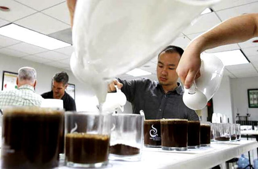Test takers must pass 22 sensory tests rating coffees by taste and smell.