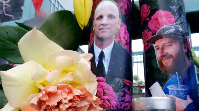 In this Wednesday, May 31, 2017 photo, candles with photos of Taliesin Namkai-Meche, right, and Rick