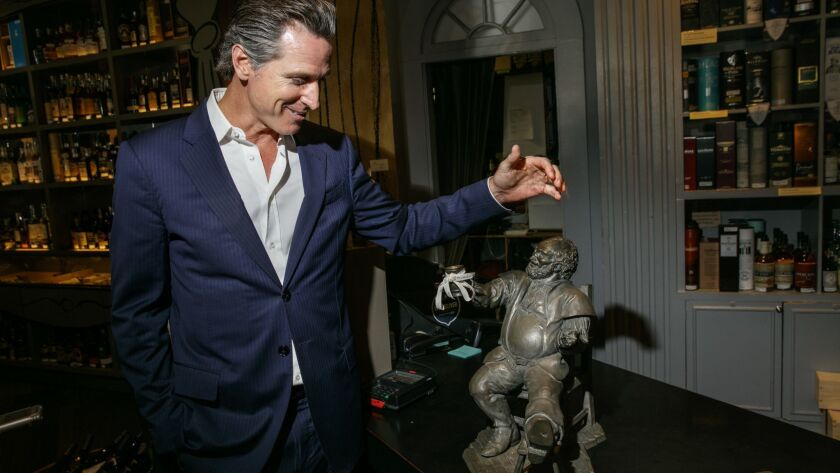 SAN FRANCISCO,CA --THURSDAY, JUNE 15, 2017--Lt. Gov. Gavin Newsom discussing a statue given to him b