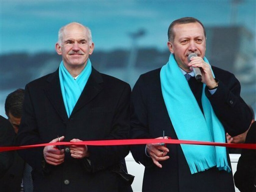 Greek PM George Papandreou, left, and his Turkish counterpart Recep Tayyip Erdogan seen during a ceremony for the 2011 Winter Universiade, or Winter University Games, an Olympic-style event that will take place later this month in the eastern city of Erzurum, Turkey, Friday, Jan. 7, 2011. Papandreou is in Erzurum to address Turkish ambassadors at a meeting.(AP Photo)