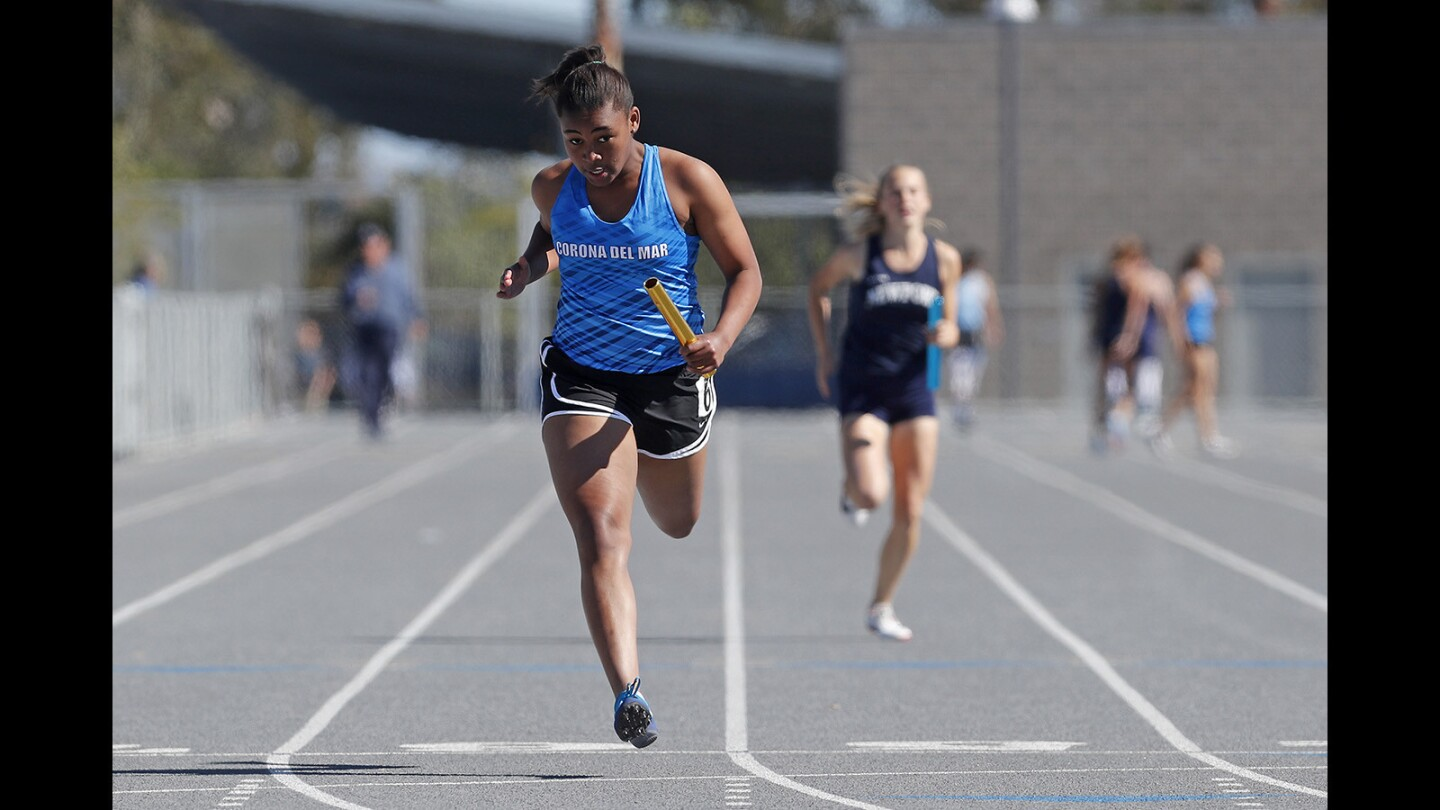 Corona del Mar High freshman Meghan Jordan finishes first in the girls' 400-meter relay during the Battle of the Bay track and field meet on Thursday, March 15.