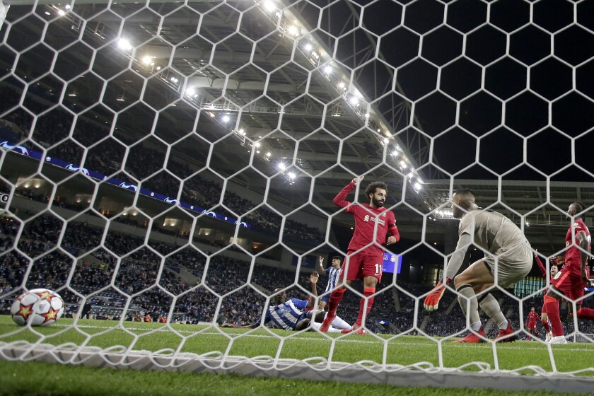 Liverpool's Mohamed Salah, center, celebrates after scoring the opening goal during the Champions League group B soccer match between FC Porto and Liverpool at the Dragao stadium in Porto, Portugal, Tuesday, Sept. 28, 2021. (AP Photo/Luis Vieira)