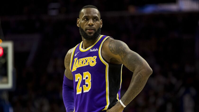 Los Angeles Lakers' LeBron James looks on during the second half of an NBA basketball game against t