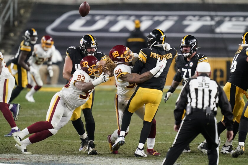 Pittsburgh Steelers quarterback Ben Roethlisberger is hit by Washington Football Team defensive end Chase Young.