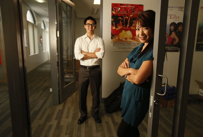 Brian Hu, left, the associate artistic director, and  Lee Ann Kim, the organizer of the San Diego Asian Film Festival at their offices in NTC. Photo: Peggy Peattie/San Diego Union-Tribune