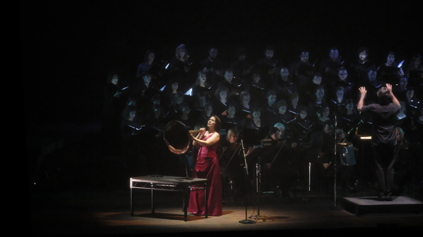 """Soprano Jessica Rivera performs during the """"Hubble Cantata"""" at the Ford Theatre in Los Angeles on Oct. 11, 2017. Paula Prestini's outer-space work' presented by the Ford Theatres and L.A Opera, is being touted as immersive opera, part science experiment and part virtual reality hoedown."""