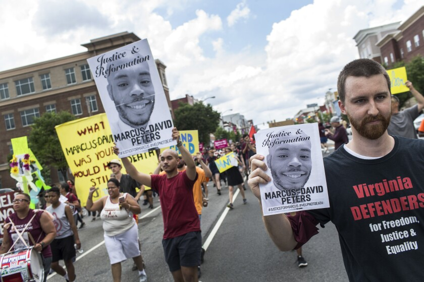 FILE - In this June 2, 2018, file photo, marchers for Marcus-David Peters shout as they head to Richmond Police Headquarters from VCU's Siegel Center in Richmond, Va. Around the U.S., protesters have been calling for prosecutors to take a second look at police killings of Black people, including Peters. Peters was shot May 14 by a Richmond police officer after a confrontation on Interstate 95. (Daniel Sangjib Min/Richmond Times-Dispatch via AP, File)