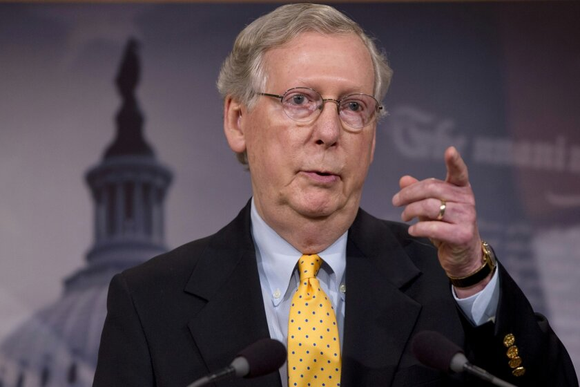 In this photo taken Aug. 6, 2015, Senate Majority Leader Mitch McConnell speaks during a news conference on Capitol Hill in Washington. The Senate is on track to advance legislation to prevent the government from shutting down after a midnight Wednesday deadline. But a move by McConnell to strip the measure of language to take away federal funding from Planned Parenthood has rankled conservatives such as Ted Cruz, R-Texas, and tea partyers in the House. (AP Photo/Jacquelyn Martin)