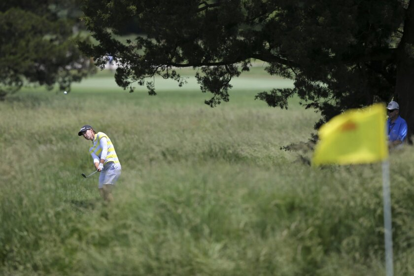 Karine Icher, of France, hits from the rough on the ninth hole of the second round of the ShopRite LPGA Classic golf tournament, Saturday, June 4, 2016, in Galloway Township, N.J.(AP Photo/Mel Evans)