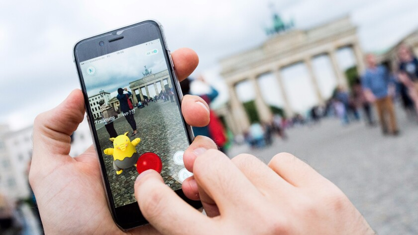 "While gamers play ""Pokemon Go"" in countries where it's been released -- here a man plays near Berlin's Brandenburg Gate -- Chinese have been finding innovative ways to get their hands on the game."