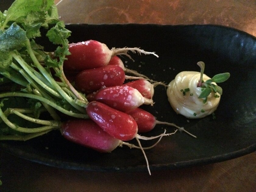 Eat with your hands: Radishes, Maldon salt and coriandar aioli at Común Kitchen and Tavern.