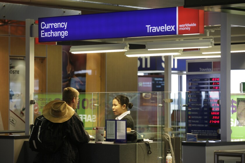 FILE - In this Monday, June 7, 2010, file photo, a Travelex Group currency exchange booth is shown at Seattle-Tacoma International Airport in Seattle. A week after a malicious virus infected its network, the London-based foreign currency exchange company Travelex has yet to restore digital sales and was reported infected with ransomware by hackers threatening to release personal data unless it pays a $3 million ransom. In a Jan. 2, 2020, Twitter post, the company said the virus had compromised some of its services on New Year's Eve and that it took all systems offline immediately. (AP Photo/Ted S. Warren, File)