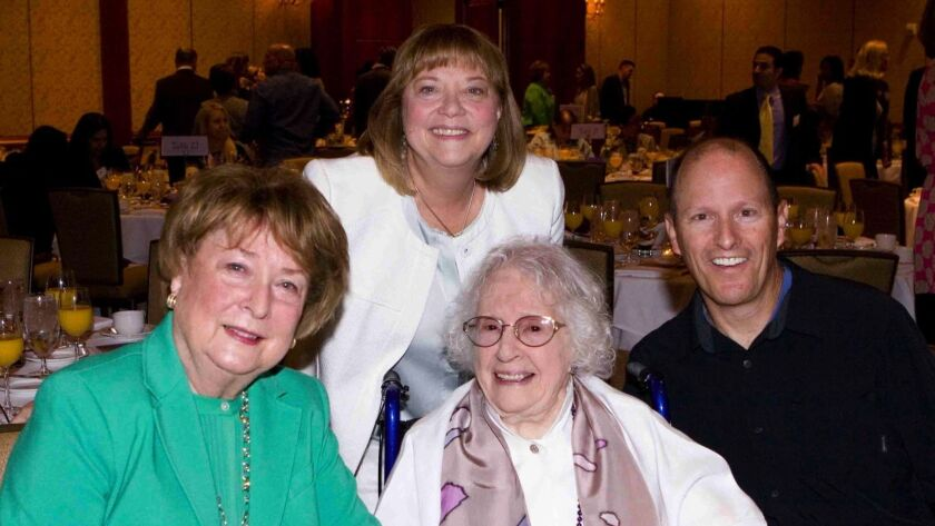 """Dana Point resident Faith Strong, center, has published her sixth book, """"The Glories of Aging."""" She is pictured in 2015 with philanthropist Carole Pickup, left, Dan Carracino and Rebecca Flood, CEO of New Directions For Women."""