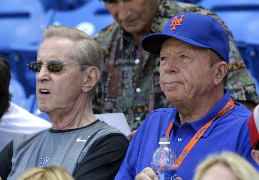 FILE- In this March 22, 2012, file photo, New York Mets owners Fred Wilpon, left, and Saul Katz watch a spring training baseball game between the Mets and the Houston Astros in Port St. Lucie, Fla. The Mets' primary owners and their affiliates owe at most about $61 million to the trustee for Bernar
